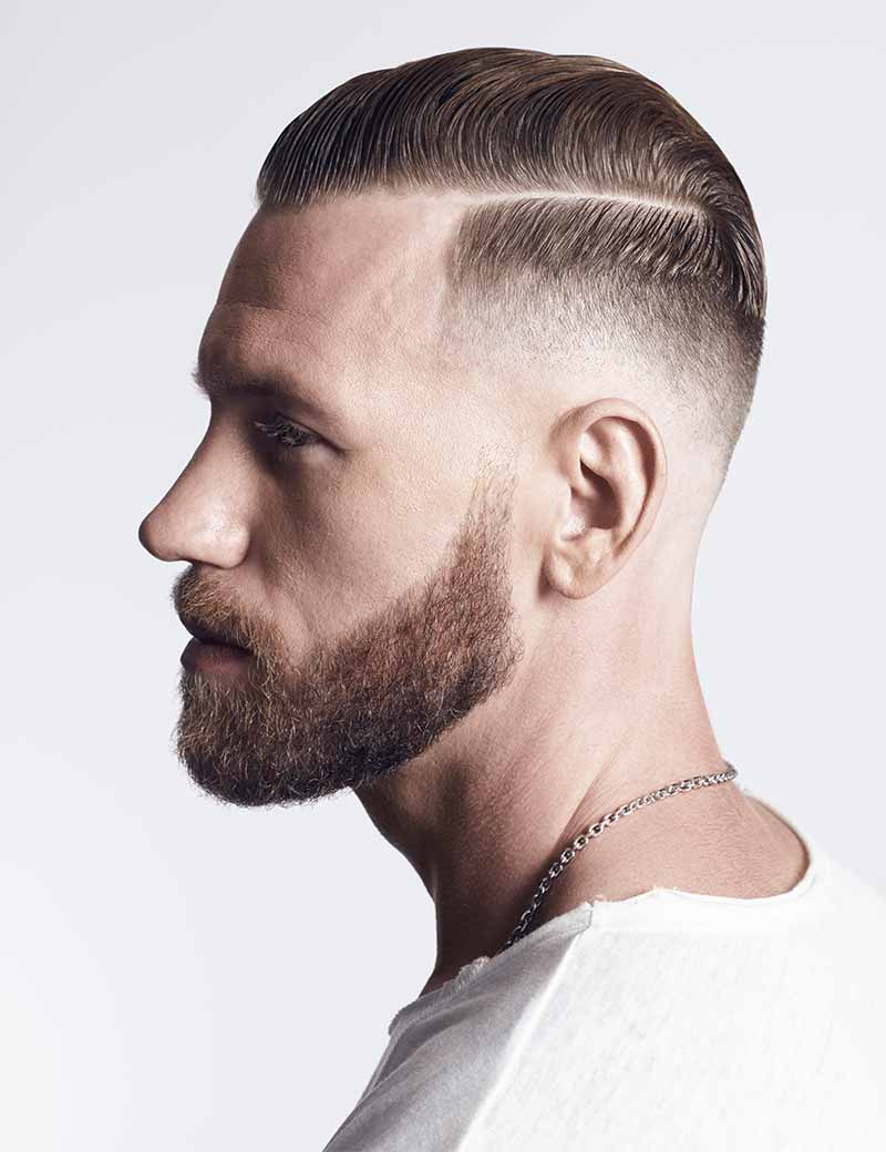 man with faded haircut styled using Redken Brew Wax Pomade