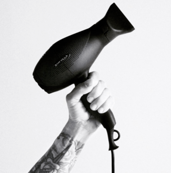 Stylist holding a blow dryer