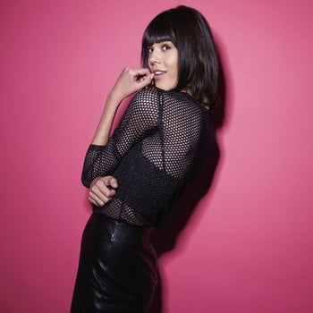 Model with black hair and pink background
