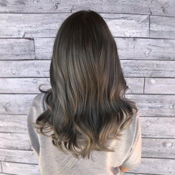 Cool-toned ashy brunette hair suitable for a medium skin tone.