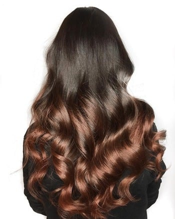 Dark brown hair with rose gold ombré ends.