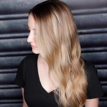 Dark root smudging haircolor technique with sun-kissed blonde haircolor.