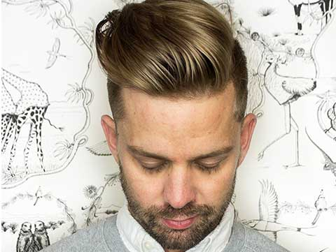 Men's pompadour on blonde hair with shaved haircut created by Redken Artist Jamie DiGrazia.