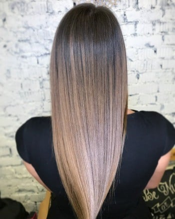 Ashy light brown ombré haircolor on straight hair.