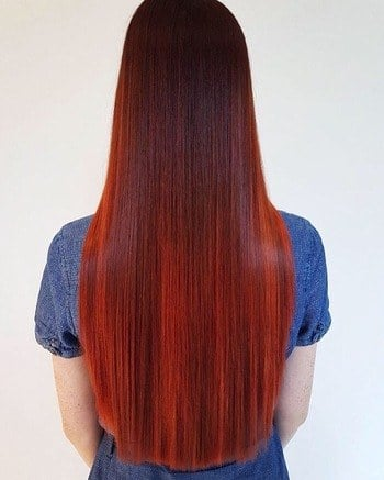 Long straight bright red ombré haircolor.