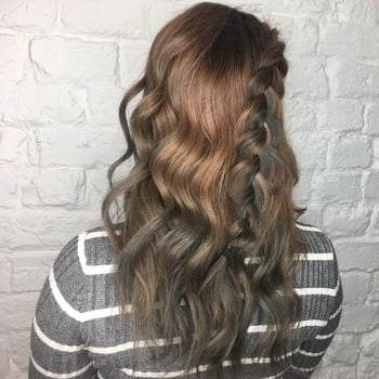 Light brown roots and dark gray wavy ombré hair.