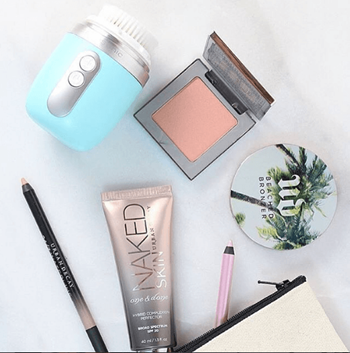 Makeup and skincare products in a makeup bag.