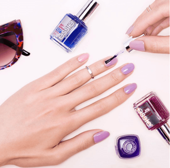 Model painting nails with purple nail polish