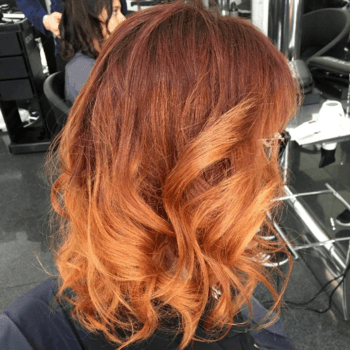 CAYENNE RED BALAYAGE. Model with bright orange