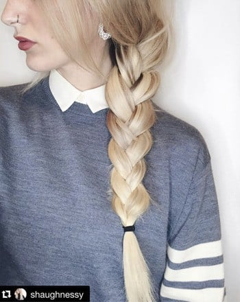 Blonde model with thick braided hairstyle