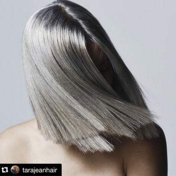 Edgy hair cut on model with silver grey hair