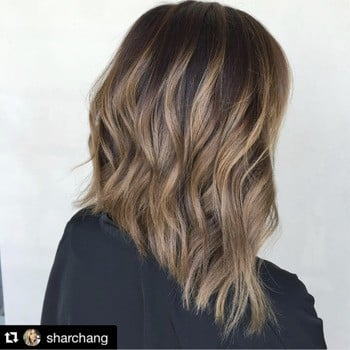 model with long layers and blonde highlights