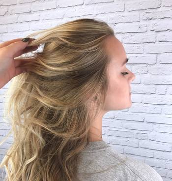 Girl with blonde highlights and wavy hair