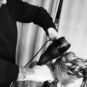 Redken Stylist blow drying hair