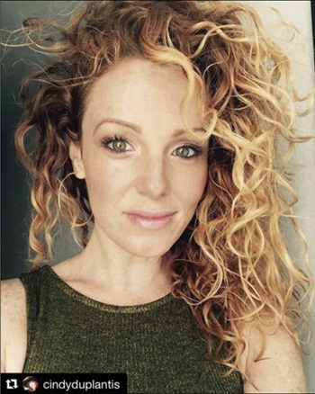 Curly haired Redken Canada Artist, Cindy Duplantis shows off her blonde locks