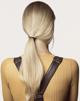 Model with blonde hair and yellow sweater