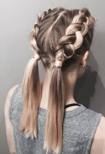 Thick double dutch braids are one of the biggest summer updos of the season.