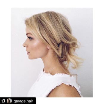 Blonde model with balayage and white top