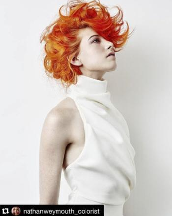 Model with short hair and bright orange hair color