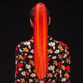 An orange red ponytail that can be lifted with bobby pins.