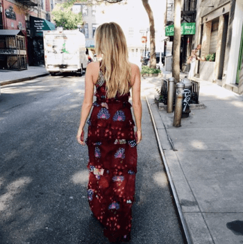 Blonde model in red dress walking down the streets of NYC