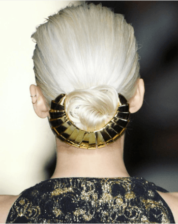 Blonde model with low bun and gold hair barrette
