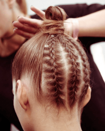 Intricate braided top knot on brunette model