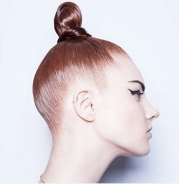 Sleek, shiny high bun hairstyle