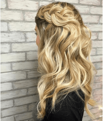 Blonde model with wavy hair and think braid created by Megan Hollinger.