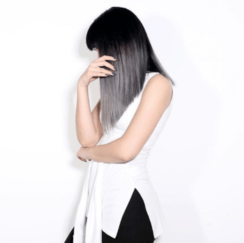 Model with grey and black ombre hair color