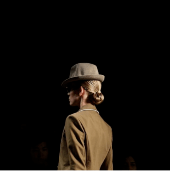 Model wearing hat walking the runway