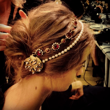 Elegant hairstyle with hair accessories created by Redken Global Creative Director, Guido Palau for Dolce & Gabbana.