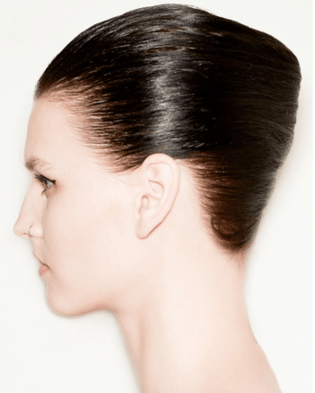 Model with sleek updo created by Redken Creative Director Guido Palau for New York Fashion Week.