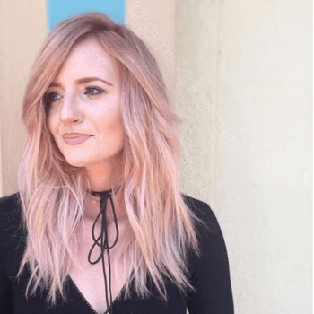Model with dusty rose hair color created by Redken Artist, Sami Skinner