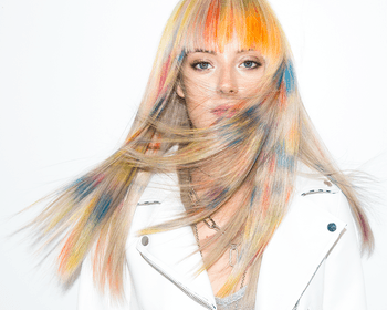 Redken Muse Chloe Norsgaard with rainbow blonde haircolor featuring Redken City Beats