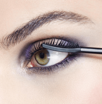 Bat your lashes all night long with black mascara.
