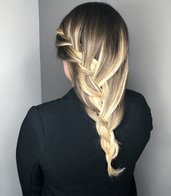 A swide-swept braid uses a waterfall braiding technique to help keep hair off of the face.