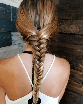 Add a twist at the top of a classic fishtail for a chic second day hair look.