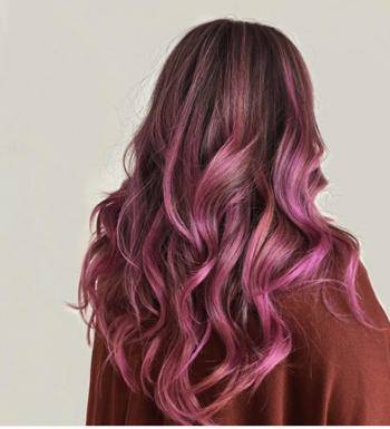 Woman with brunette hair and pink peekaboo haircolor