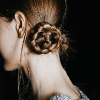 Braided side bun created by Redken Global Creative Director, Guido Palau