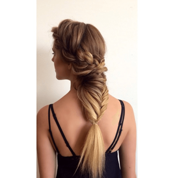 Model with warm blonde hair and big, intricate braid