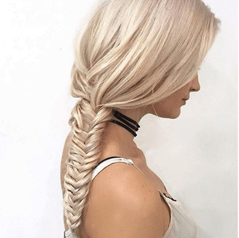 Sleek fishtail braid hairstyle on platinum blonde model