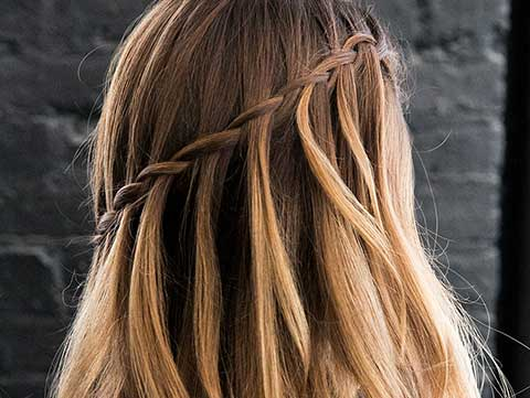 Step up your spring hairstyle by learning how to do a waterfall braid.