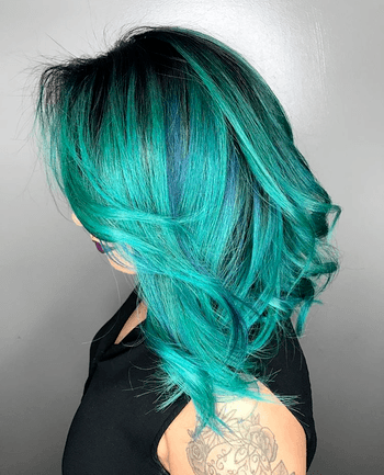 The emerald hues found in this look make for mermaid-inspired hair.