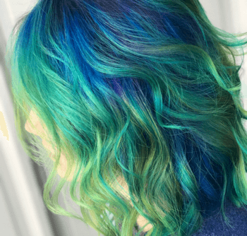 Fit for a true sea-dwelling goddess, this mermaid look is tinged with vivid hues of green and blue.