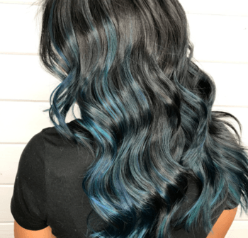 Oil slicked hair offers an opportunity for lustrous shine in this dark mermaid hair variation.