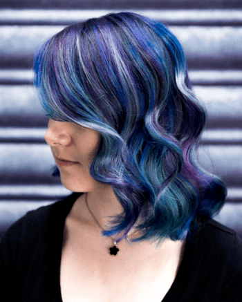 Vibrant pieces of violet help this look transition away from traditional mermaid hair.