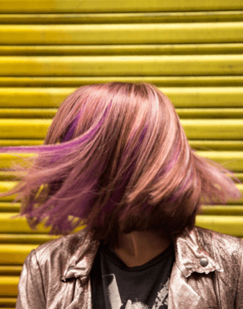 Metallic rose gold hair blends multidimensional pink and purple hair.