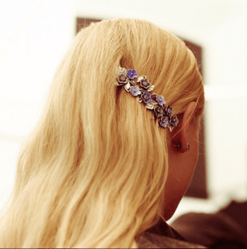 Blonde model with purple flower barrette