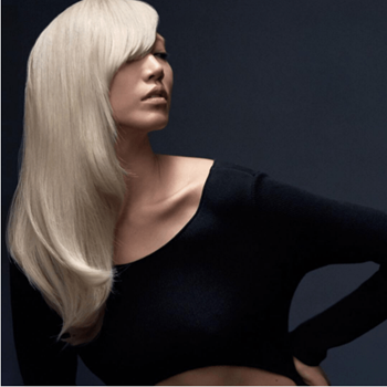 Redken muse and model, Soo Joo Park models shiny platinum blonde hair and side swept bangs.